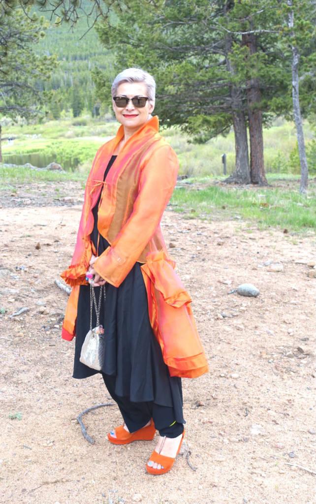 Suzanna Redford from Texas is wearing an orange silk organza jacket