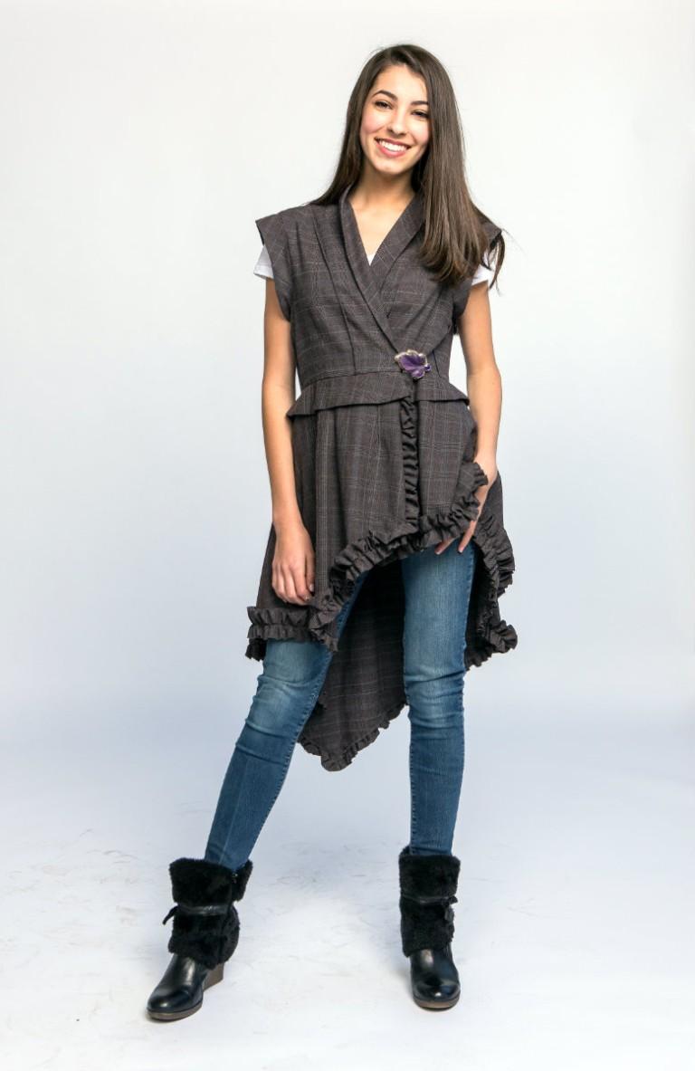 Alex in a ruffled wool vest